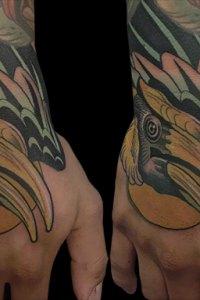 bird hand tattoo by Justin Acca