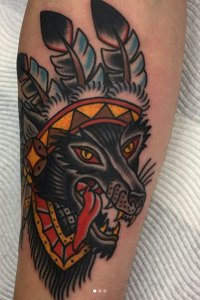 Andrew Timmins Wolf wearing American Indian headress tattoo in Traditional Style