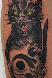 black cat green eyes skull tattoo by brendan courts